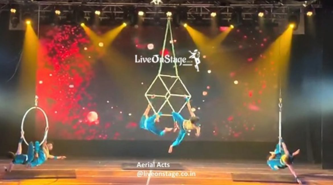 Aerial Silk, Aerial Cube, Aerial Rope, Aerial trio, Aerial duo, Aerial swinging act, Aerial Stunts, Flying Stunts, Multiple Aerial Performers, Stage Shows, Aerial Show Production, Live On Stage, Live On Stage Weddings, Product Launch, Bollywood Movies, Television Shows, Ad Commercials, Aerial Trapeze Act,